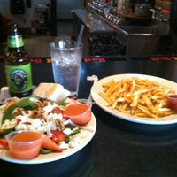 Photo taken at Pleasant City Wood Fired Grill by Julie L. on 1/10/2013
