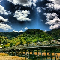 Photo taken at Togetsu-kyo Bridge by Oenophile w. on 4/22/2013