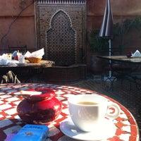 Photo taken at Jnane Mogador Hotel by Tijen K. on 12/18/2014