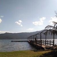 Photo taken at Ponta das Caranhas by Leandro B. on 5/9/2014