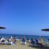 Photo taken at St-Raphael Beach by Lazar B. on 7/31/2013