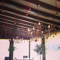 Photo taken at Smallworld Cafe by Veronika K. on 12/3/2013