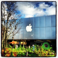 Photo taken at Apple University Village by Naoki T. on 12/21/2012