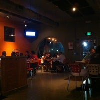 Photo taken at Tucci's Fire N Coal Pizza by April A. on 10/19/2012