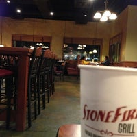 Photo taken at Stonefire Grill by Derick T. on 1/26/2013