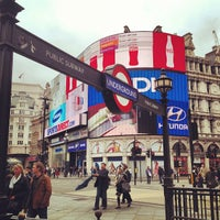 Photo taken at Piccadilly Circus by David H. on 5/30/2013