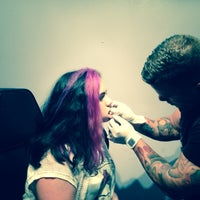 Photo taken at Salvation Tattoo Lounge by Janet F. on 7/17/2014