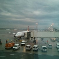 Photo taken at Gate A05 by Xiao Z. on 7/4/2014