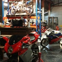 Photo taken at Carbon Garage by Tracy F. on 6/14/2014