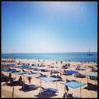 Photo taken at Praia do Barril by Anechka R. on 8/11/2013