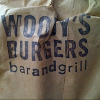 Photo taken at Woody's Burgers bar and grill by Christine K. on 3/24/2013