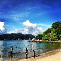 Photo taken at Paradise Beach by Xuan Jie C. on 5/4/2013