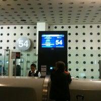 Photo taken at Sala/Gate 54 by Nacho M. on 12/26/2012