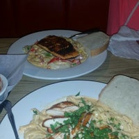 Photo taken at Louie's Grill Fusion Restaurant by Chris W. on 10/9/2014