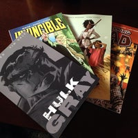 Photo taken at Earth2Comics by Drew B. on 3/22/2014