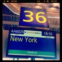 Photo taken at Gate 50 by Alexei C. on 10/10/2012