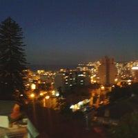 Photo taken at Viña del Mar Alto by Cami I. on 1/1/2014