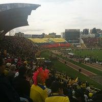 Photo taken at Estadio Olimpico Atahualpa by Dennis M. on 10/12/2012