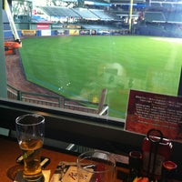 Photo taken at TGI Fridays Front Row Sports Grill by Erica R. on 3/16/2013