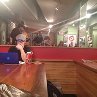 Photo taken at Small World Coffee by Itai B. on 12/2/2012