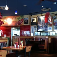 Photo taken at Red Robin Gourmet Burgers by Robson F. on 10/10/2012