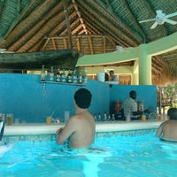 Photo taken at Poolbar Haciënda Dominicus by Nelson A. on 7/22/2013