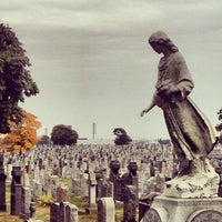 Photo taken at New Calvary Cemetery by Will C. on 10/31/2013