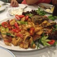 Photo taken at Cunda Balık Restaurant by Yılmaz Kaizen on 7/5/2013