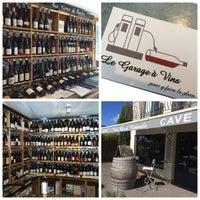 Photo taken at Le Garage A Vins by Nathalie C. on 7/14/2016