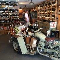 Photo taken at Le Garage A Vins by Nathalie C. on 7/25/2014