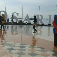 Photo taken at Losari Beach Makassar by Julia P. on 4/14/2013