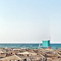 Photo taken at Suma Beach by Burcu G. on 7/13/2013