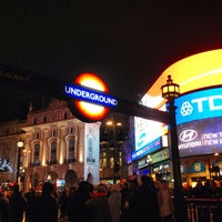 Photo taken at Piccadilly Circus by Amanda D. on 4/14/2013