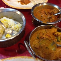 Photo taken at Calcutta Indian Cuisine by Caryn H. on 12/16/2013