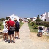 Photo taken at Praia do Barril by César S. on 7/20/2013