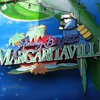 Photo taken at Jimmy Buffett's Margaritaville by Chris J. on 3/22/2013