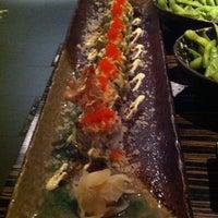 Photo taken at Dozo Sushi by Manuela I. on 11/24/2012