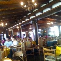 Photo taken at Rincón Del Puga by Reyna B. on 12/23/2012