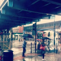Photo taken at Kilburn London Underground Station by Brigid H. on 10/3/2012