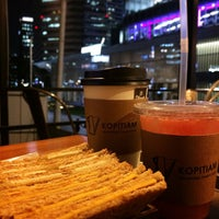 Photo taken at Kopitiam Singapore Toast Cafe by In-young L. on 10/6/2014