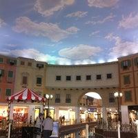 Photo taken at Villaggio Mall by Khaula R. on 1/9/2013