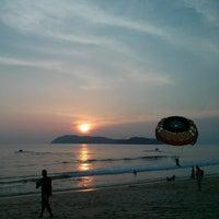 Photo taken at Pantai Cenang (Beach) by Adrian G. on 7/26/2013