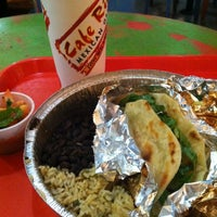 Photo taken at Cafe Rio Mexican Grill by Rick R. on 4/17/2013