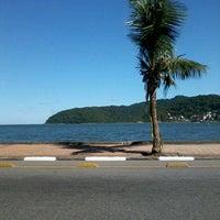 Photo taken at Praia do Gonzaguinha by Samara K. on 4/22/2013