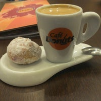 Photo taken at Café Donuts by Lincoln C. on 3/11/2014