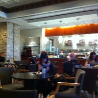 Photo taken at Delta Sky Club by Troy H. on 10/13/2012