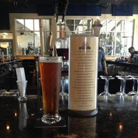 Photo taken at Latitude 42 Brewing Company by Greg C. on 10/13/2013