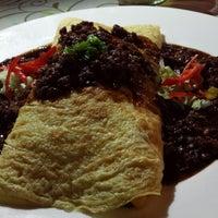 Photo taken at Junction Café & Restaurant by Irene K. on 6/4/2014