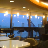 Photo taken at Delta Sky Club by William C. on 5/10/2013