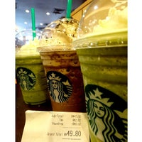 Photo taken at Starbucks by Xinyue T. on 7/4/2013